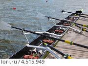 Купить «Длинная спортивная лодка с веслами стоит на деревянном причале», фото № 4515949, снято 5 июня 2011 г. (c) Losevsky Pavel / Фотобанк Лори