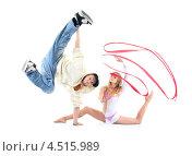 Купить «Брейкдансер стоит на одной руке и изящная гимнастка с красной лентой сидит на полу», фото № 4515989, снято 13 сентября 2011 г. (c) Losevsky Pavel / Фотобанк Лори
