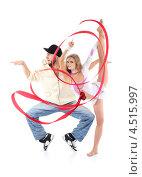 Купить «Брейкдансер стоит на цыпочках и изящная гимнастка с красной лентой стоит на одной ноге», фото № 4515997, снято 13 сентября 2011 г. (c) Losevsky Pavel / Фотобанк Лори