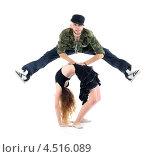 Купить «Рэпер перепрыгивает через гимнастку», фото № 4516089, снято 13 сентября 2011 г. (c) Losevsky Pavel / Фотобанк Лори