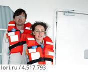 Купить «Мужчина и женщина в спасательных жилетах на теплоходе», фото № 4517793, снято 31 июля 2011 г. (c) Losevsky Pavel / Фотобанк Лори