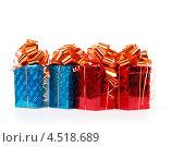 Купить «Четыре подарочные коробки с блестящими бантами на белом», фото № 4518689, снято 16 декабря 2011 г. (c) Losevsky Pavel / Фотобанк Лори