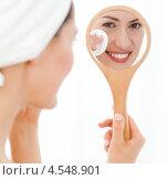 Купить «Симпатичная женщина в банном полотенце на голове делает маникюр», фото № 4548901, снято 28 октября 2010 г. (c) Wavebreak Media / Фотобанк Лори