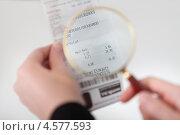 Купить «Контроль и учет расходов. Деловая женщина рассматривает чек через лупу», фото № 4577593, снято 14 июня 2012 г. (c) Андрей Попов / Фотобанк Лори
