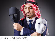 Купить «Араб с двумя театральными масками», фото № 4588921, снято 26 октября 2012 г. (c) Elnur / Фотобанк Лори