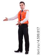 Купить «Мужчина в защитном оранжевом жилете», фото № 4599817, снято 3 февраля 2013 г. (c) Elnur / Фотобанк Лори