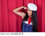 Купить «Сексуальная притягательная брюнетка в наряде морячки на красном фоне смотрит из-под руки», фото № 4648813, снято 16 июля 2012 г. (c) Андрей Попов / Фотобанк Лори