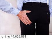 Харрасмент - сексуальные домогательства на работе. Стоковое фото, фотограф Андрей Попов / Фотобанк Лори