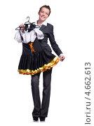 Купить «Женщина в брючном костюме держит в руках короткое платье», фото № 4662613, снято 7 февраля 2013 г. (c) Elnur / Фотобанк Лори