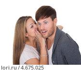 Купить «Девушка рассказывает парню на ушко секрет», фото № 4675025, снято 20 октября 2012 г. (c) Андрей Попов / Фотобанк Лори