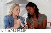 Купить «Woman putting salt and pepper in pot while cooking», видеоролик № 4686329, снято 27 мая 2020 г. (c) Wavebreak Media / Фотобанк Лори