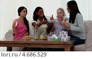 Купить «Friends eating snacks with flutes of champagne», видеоролик № 4686529, снято 8 июля 2020 г. (c) Wavebreak Media / Фотобанк Лори