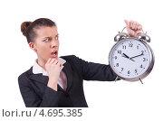 Купить «Деловая женщина с тревогой смотрит на будильник», фото № 4695385, снято 8 января 2013 г. (c) Elnur / Фотобанк Лори