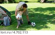 Купить «Father and son playing with a football», видеоролик № 4702113, снято 17 июля 2019 г. (c) Wavebreak Media / Фотобанк Лори