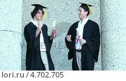 Купить «Two graduates giving high-five», видеоролик № 4702705, снято 5 апреля 2020 г. (c) Wavebreak Media / Фотобанк Лори