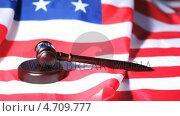 Купить «Gavel raised on an American flag», видеоролик № 4709777, снято 6 июля 2020 г. (c) Wavebreak Media / Фотобанк Лори