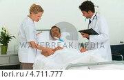 Doctors examining a sick man. Стоковое видео, агентство Wavebreak Media / Фотобанк Лори