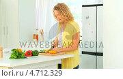 Купить «Lovely blond woman cooking», видеоролик № 4712329, снято 27 мая 2020 г. (c) Wavebreak Media / Фотобанк Лори