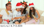Купить «Family during Christmas with crackers», видеоролик № 4713809, снято 23 августа 2019 г. (c) Wavebreak Media / Фотобанк Лори