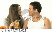 Купить «Woman kissing her boyfriend and drinking orange juice», видеоролик № 4719621, снято 23 июля 2019 г. (c) Wavebreak Media / Фотобанк Лори