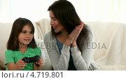 Купить «Mother and daughter playing video games », видеоролик № 4719801, снято 17 июля 2019 г. (c) Wavebreak Media / Фотобанк Лори