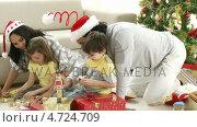 Купить «Family playing with Christmas gifts at home», видеоролик № 4724709, снято 23 августа 2019 г. (c) Wavebreak Media / Фотобанк Лори