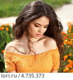 Купить «Красивая брюнетка в оранжевых цветах календулы», фото № 4735373, снято 24 апреля 2013 г. (c) Photobeauty / Фотобанк Лори