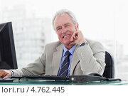 Купить «Радостный пожилой мужчина работает на компьютере сидя в офисе», фото № 4762445, снято 10 ноября 2011 г. (c) Wavebreak Media / Фотобанк Лори