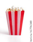 Купить «Стакан попкорна на белом фоне», фото № 4774349, снято 23 декабря 2012 г. (c) Андрей Попов / Фотобанк Лори