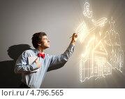 Купить «Молодой бизнесмен рисует в воздухе светящийся график», фото № 4796565, снято 1 марта 2013 г. (c) Sergey Nivens / Фотобанк Лори