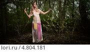 Купить «Светловолосая девушка в длинном платье в лесу», фото № 4804181, снято 7 мая 2010 г. (c) Станислав Фридкин / Фотобанк Лори