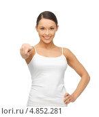 Купить «Счастливая девушка показывает пальцем вперед», фото № 4852281, снято 12 января 2013 г. (c) Syda Productions / Фотобанк Лори