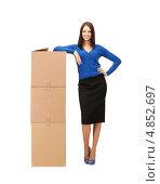Купить «Деловая девушка в синей кофте с коробками на белом фоне», фото № 4852697, снято 2 апреля 2011 г. (c) Syda Productions / Фотобанк Лори