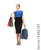 Купить «Деловая женщина в длинной юбке с покупками в пакетах», фото № 4852701, снято 2 апреля 2011 г. (c) Syda Productions / Фотобанк Лори