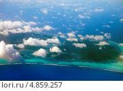 Полинезия. Вид на острова в океане сквозь облака, фото № 4859257, снято 22 июня 2011 г. (c) Куликов Константин / Фотобанк Лори