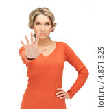 Купить «Молодая женщина в красном джемпере показывает рукой стоп», фото № 4871325, снято 24 марта 2012 г. (c) Syda Productions / Фотобанк Лори