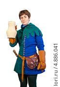 Купить «Довольная молодая женщина в средневековом мужском сине-зеленом костюме держит белый кувшин», фото № 4886041, снято 20 июля 2013 г. (c) Иван Марчук / Фотобанк Лори