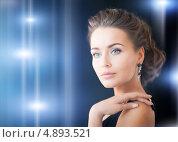 Купить «Молодая красивая женщина с драгоценными камнями в ушах», фото № 4893521, снято 17 марта 2013 г. (c) Syda Productions / Фотобанк Лори