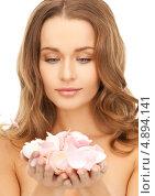 Купить «Красивая женщина с лепестками роз на белом фоне», фото № 4894141, снято 10 октября 2010 г. (c) Syda Productions / Фотобанк Лори