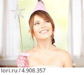 Купить «Девушка с волшебной палочкой на вечеринке», фото № 4908357, снято 4 октября 2009 г. (c) Syda Productions / Фотобанк Лори