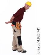 Купить «Рабочий тянет за спиной что-то невидимое», фото № 4926741, снято 9 июня 2011 г. (c) Phovoir Images / Фотобанк Лори
