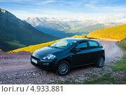 Купить «Черный автомобиль на фоне гор, Испания», эксклюзивное фото № 4933881, снято 3 июля 2013 г. (c) Яков Филимонов / Фотобанк Лори