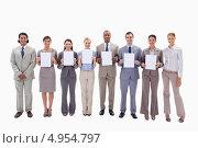 Купить «Коллеги по бизнесу стоят в ряд и держат пустые таблички под буквы в количестве 6 штук», фото № 4954797, снято 9 ноября 2011 г. (c) Wavebreak Media / Фотобанк Лори