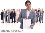 Купить «Девушка с документом на планшете на фоне большой группы деловых людей», фото № 4955697, снято 8 ноября 2011 г. (c) Wavebreak Media / Фотобанк Лори