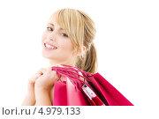 Купить «Счастливая девушка с покупками в пакетах», фото № 4979133, снято 3 января 2009 г. (c) Syda Productions / Фотобанк Лори