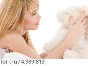 Любимая мягкая игрушка - лучший друг юной девушки. Стоковое фото, фотограф Syda Productions / Фотобанк Лори