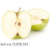 Купить «Две половинки зеленого яблока на белом фоне», фото № 5070101, снято 13 марта 2012 г. (c) Natalja Stotika / Фотобанк Лори