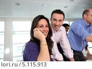 Купить «Девушка в офисе получила радостные новости по телефону», фото № 5115913, снято 20 января 2010 г. (c) Phovoir Images / Фотобанк Лори