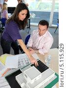 Купить «Группа архитекторов в офисе обсуждают макет здания», фото № 5115929, снято 20 января 2010 г. (c) Phovoir Images / Фотобанк Лори