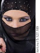 Купить «Девушка в черной парандже с ярким макияжем на глазах», фото № 5127189, снято 1 июля 2008 г. (c) Syda Productions / Фотобанк Лори